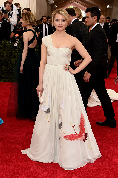Glee Star Dianna Agron is wearing a gown, small clutch, and shoes by designer Tory Burch with Fred Leighton jewelry.