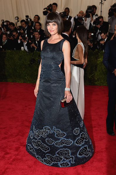 Katie Holmes with a bob wig wearing a cutout Zac Posen gown, Roger Vivier shoes and custom bag, and Chopard jewelry.