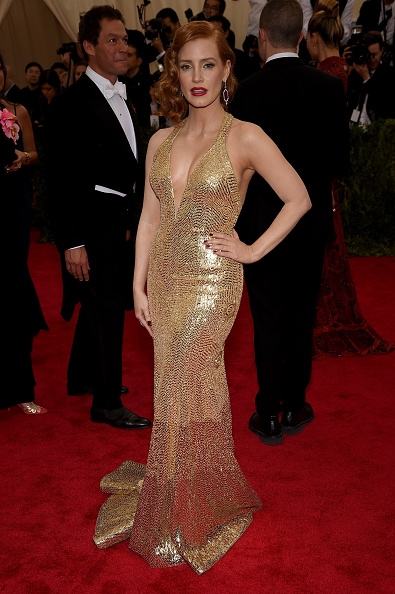 Jessica Chastain is a golden goddess in a gold Givenchy gown and Piaget jewelry.