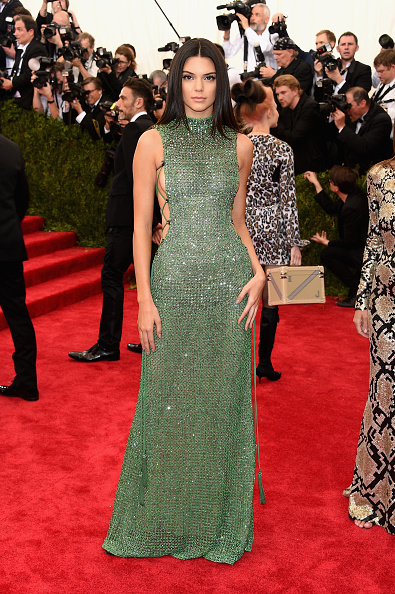 Kendall Jenner is a gem in this emerald crystal encrusted gown by Calvin Klein Collection and Chopard jewelry.