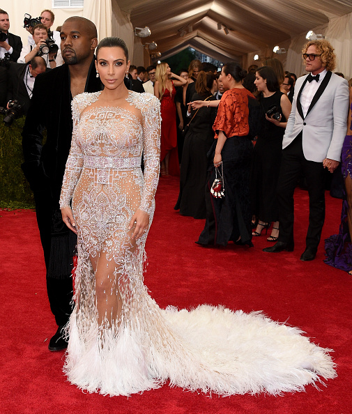 Kim Kardashian walked the red carpet in a sheer see-through embroidered gown from Roberto Cavalli by Peter Dundas.