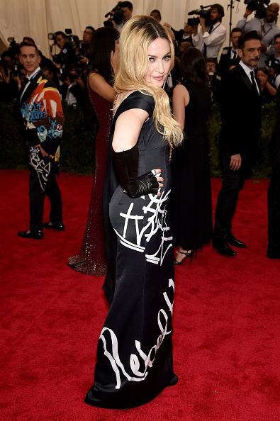 Madonna wrote her own script in this black strapless gown by Moschino with Rebel Heart scribbled on the front.