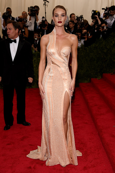 Rosie Huntington-Whiteley is shimmering in Atelier Versace gown, Christian Louboutin shoes, and Anita Ko jewelry.