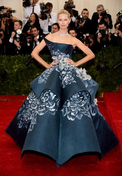 Model Karolina Kurkova is the very definition of a ball gown stunning in a one shoulder voluminous gown by Marchesa